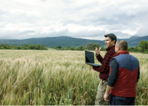 Agronomist and farmer in field